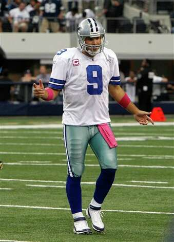 Dallas Cowboys quarterback Tony Romo (9) walks off the field late in an NFL football game against the Detroit Lions  Sunday, Oct. 2, 2011, in Arlington, Texas. Photo: LM Otero, AP / AP