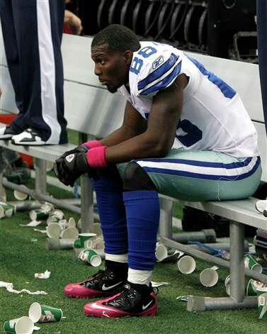 Dallas Cowboys wide receiver Dez Bryant (88) sits on the bench late in an NFL football game  against the Detroit Lions Sunday, Oct. 2, 2011, in Arlington, Texas. Photo: LM Otero, AP / AP