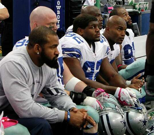 Members of the Dallas Cowboys sit on the bench late in an NFL football game against the Detroit Lions  Sunday, Oct. 2, 2011, in Arlington, Texas. Photo: LM Otero, AP / AP