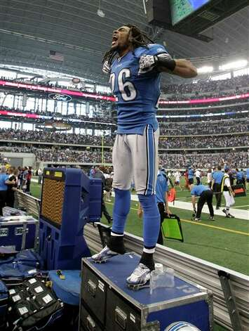 "Detroit Lions free safety Louis Delmas celebrates by yelling out ""4 and 0"" following the Lions' 34-30 win in an NFL football game against the Dallas Cowboys on Sunday, Oct. 2, 2011, in Arlington, Texas. Photo: Tony Gutierrez, AP / AP"
