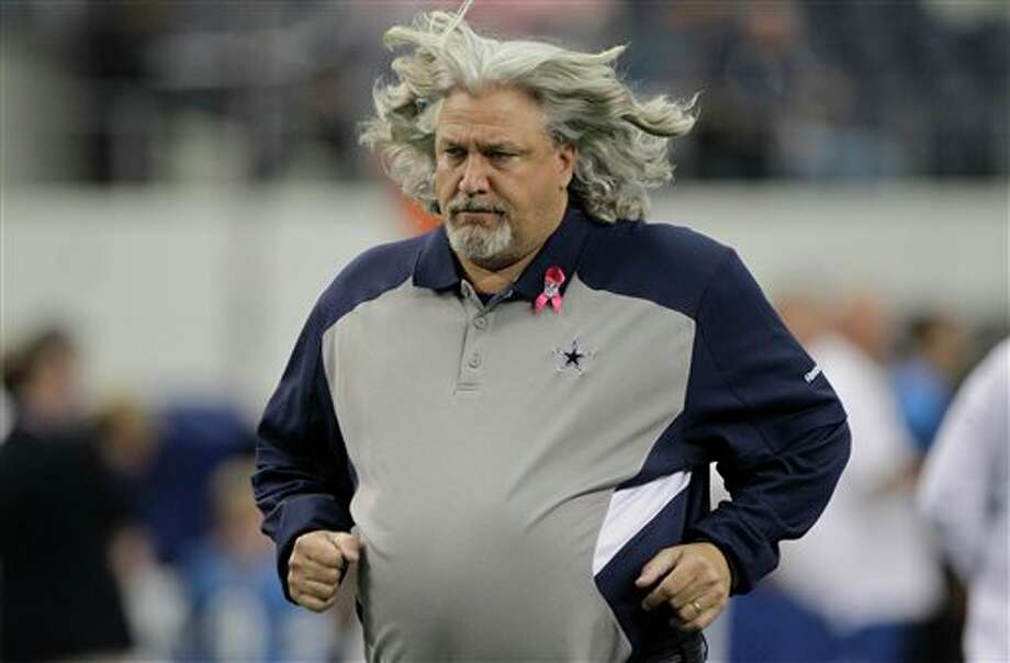 Dallas Cowboys defensive coordinator Rob Ryan runs onto the field before an NFL football game Sunday, Oct. 2, 2011, in Arlington, Texas. Photo: Tony Gutierrez, AP / AP