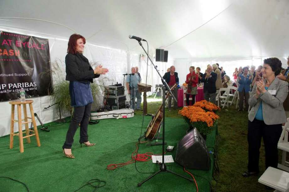 Rosanne Cash plays a benefit concert for Family Re-Entry in Greenwich, Conn., October 2, 2011. Family ReEntry is a programmed aimed at helping incarcerated people move back into society by offering individualized case management and support services. The program also aims to reduce the likelihood that clients will re-offend. Cash traces her dedication to such causes back to her father, Johnny Cash, who famously recorded a live album at Folsom State Prison in California where Roseanne Cash recently played a concert too. Photo: Keelin Daly / Stamford Advocate