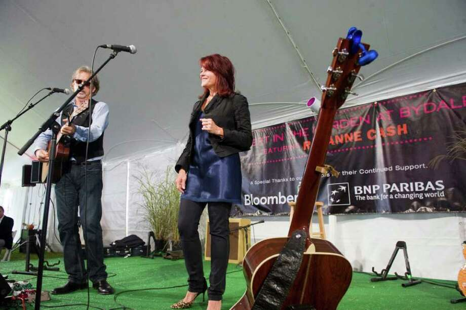 Rosanne Cash and her husband, Grammy Award winning musician John Leventhal, play a benefit concert for Family Re-Entry in Greenwich, Conn., October 2, 2011. Family ReEntry is a programmed aimed at helping incarcerated people move back into society by offering individualized case management and support services. The program also aims to reduce the likelihood that clients will re-offend. Cash traces her dedication to such causes back to her father, Johnny Cash, who famously recorded a live album at Folsom State Prison in California where Roseanne Cash recently played a concert too. Photo: Keelin Daly / Stamford Advocate