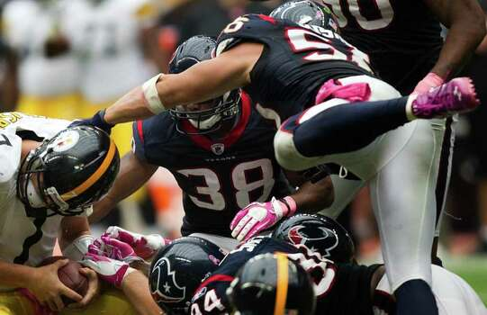 Pittsburgh Steelers quarterback Ben Roethlisberger (7) is sacked by the Houston Texans defense during the fourth quarter of an NFL football game at Reliant Stadium on Sunday, Oct. 2, 2011, in Houston. The Texans won the game 17-10. Photo: Smiley N. Pool, Houston Chronicle / © 2011  Houston Chronicle
