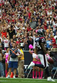 Houston Texans cornerback Johnathan Joseph (24) goes in for a touchdown that was called back because of a roughing the passer penalty during the fourth quarter of an NFL football game against the Pittsburgh Steelers at Reliant Stadium on Sunday, Oct. 2, 2011, in Houston. The Texans won the game 17-10. Photo: Smiley N. Pool, Houston Chronicle / © 2011  Houston Chronicle
