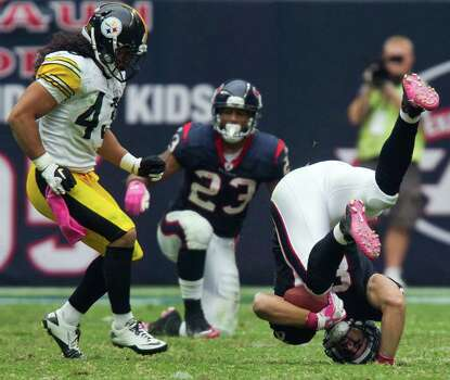Houston Texans tight end Owen Daniels (81) lands on his head after making a catch in front of Pittsburgh Steelers strong safety Troy Polamalu (43) during the second half of an NFL football game at Reliant Stadium on Sunday, Oct. 2, 2011, in Houston. The Texans won the game 17-10. Photo: Smiley N. Pool, Houston Chronicle / © 2011  Houston Chronicle