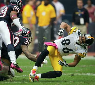 Pittsburgh Steelers wide receiver Hines Ward (86) is hit hard by Houston Texans cornerback Jason Allen (30) during the fourth quarter of an NFL football game at Reliant Stadium on Sunday, Oct. 2, 2011, in Houston. The Texans won the game 17-10. Photo: Smiley N. Pool, Houston Chronicle / © 2011  Houston Chronicle
