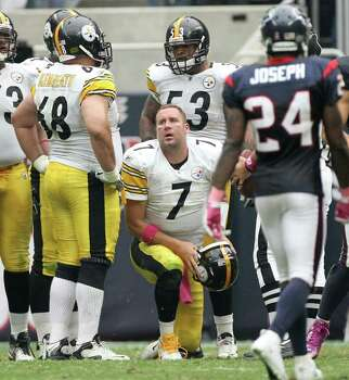 Pittsburgh Steelers quarterback Ben Roethlisberger (7) gets up after being sacked by the Houston Texans defense during the fourth quarter of a NFL football game at Reliant Stadium on Sunday, Oct. 2, 2011, in Houston. The Houston Texans won 17-10. Photo: Nick De La Torre, Houston Chronicle / © 2011  Houston Chronicle