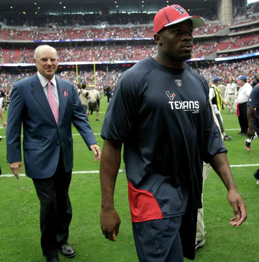 Houston Texans wide receiver Andre Johnson walks off the field with Texans owner Bob McNair at the end of an NFL football game against the Pittsburgh Steelers at Reliant Stadium on Sunday, Oct. 2, 2011, in Houston. The Texans beat the Steelers 17-10. Johnson left the game with an injury. Photo: Brett Coomer, Houston Chronicle / © 2011  Houston Chronicle
