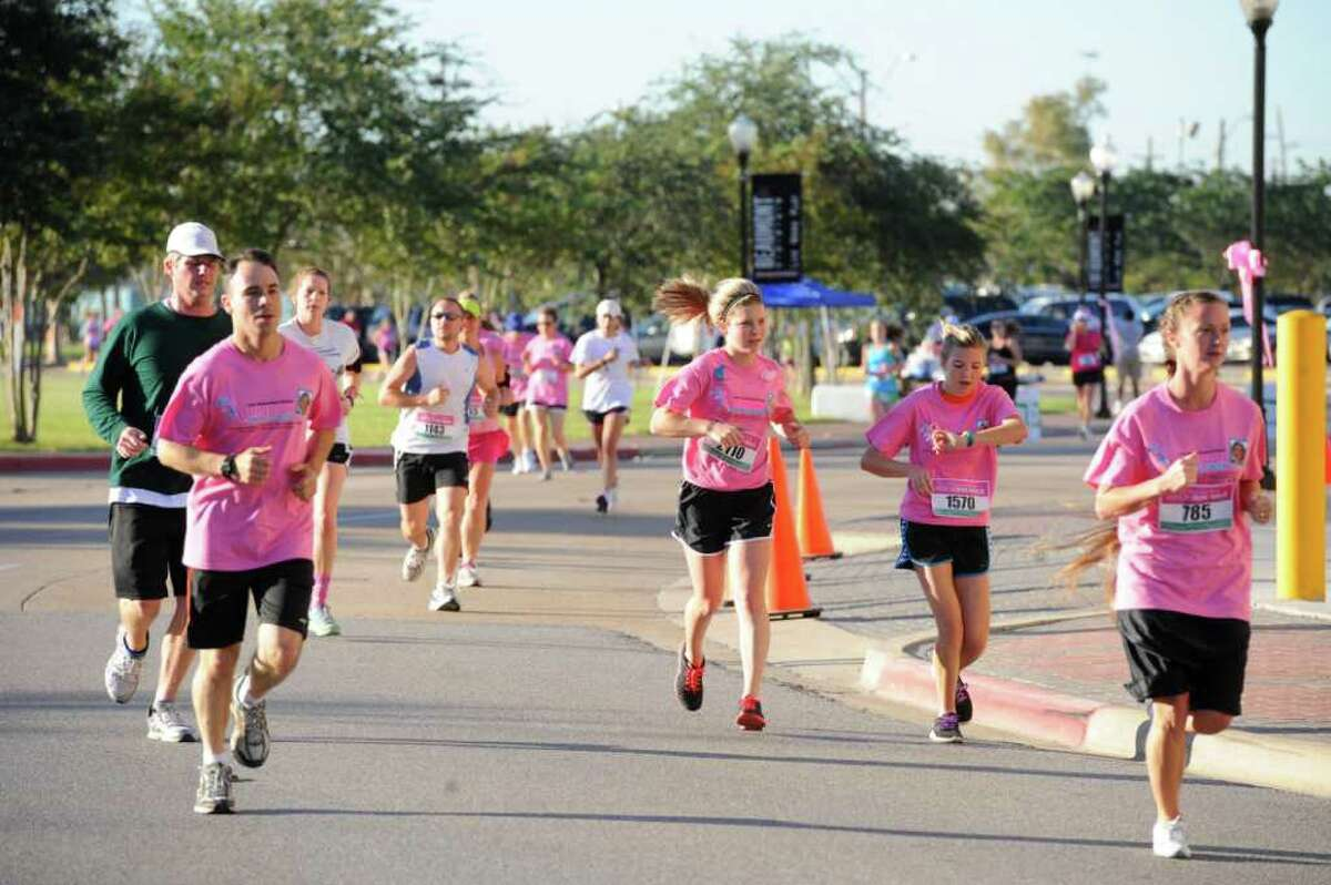 Runners race through downtown Beaumont during the Julie Richardson Procter 5K Ribbon Run/Walk on Saturday, October 1, 2011. Valentino Mauricio/The Enterprise