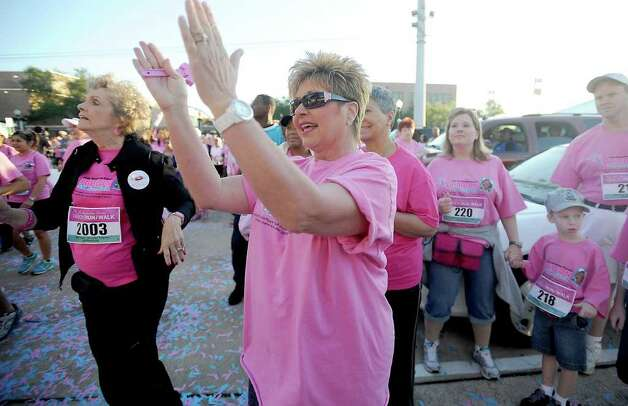 Mayor Becky Ames warms up by dancing Zumba before the Julie Richardson Procter Ribbon 5K Run/Walk in Beaumont Saturday, October 1, 2011. Tammy McKinley/The Enterprise Photo: TAMMY MCKINLEY
