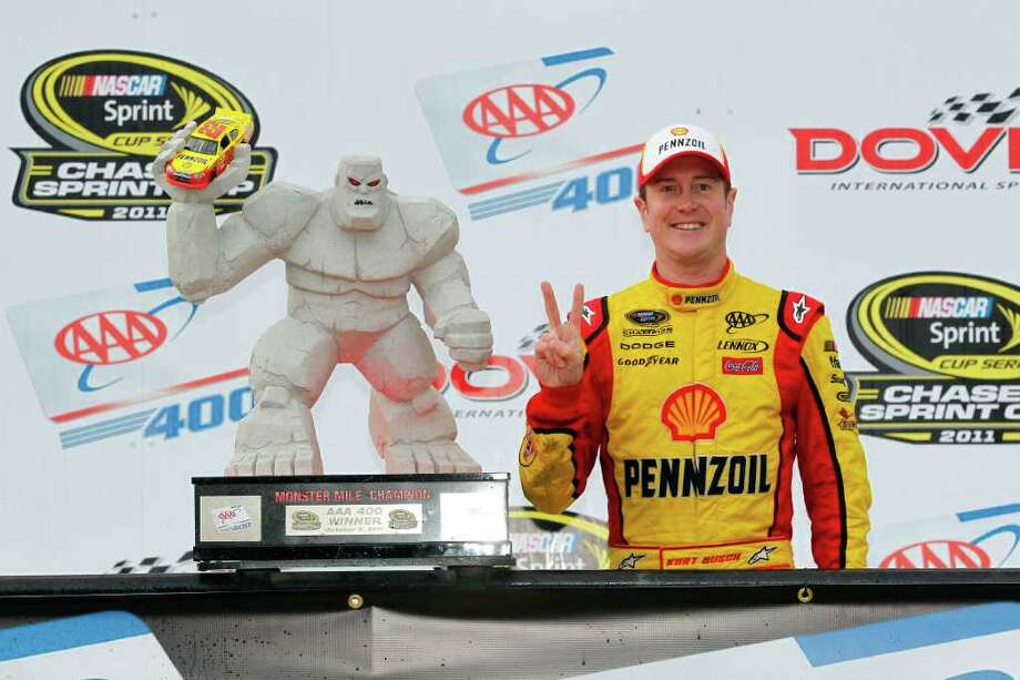 DOVER, DE - OCTOBER 02:  Kurt Busch, driver of the #22 Shell/Pennzoil Dodge, celebrates with the trophy in victory lane after winning the NASCAR Sprint Cup Series AAA 400 at Dover International Speedway on October 2, 2011 in Dover, Delaware.  (Photo by Geoff Burke/Getty Images) Photo: Geoff Burke / 2011 Getty Images