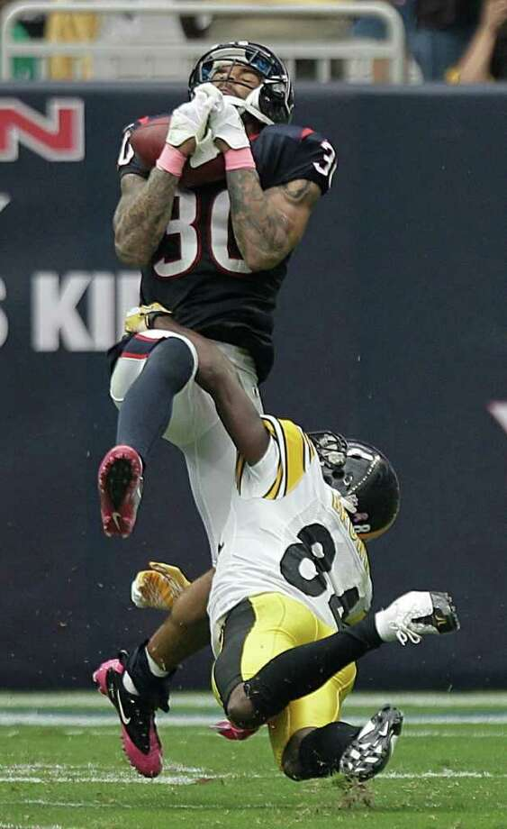 Houston Texans cornerback Jason Allen (30) intercepts a pass intended for Pittsburgh Steelers wide receiver Antonio Brown (84) during the fourth quarter of an NFL football game at Reliant Stadium on Sunday, Oct. 2, 2011, in Houston. The Texans beat the Steelers 17-10. Photo: Brett Coomer, Houston Chronicle / © 2011  Houston Chronicle