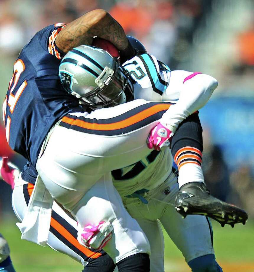 Carolina Panthers cornerback Darius Butler (27) tackles Chicago Bears running back Matt Forte (22) during third-quarter action at Soldier Field in Chicago, Illinois, Sunday, October 2, 2011. The Bears defeated the Panthers 34-29. (Jeff Siner/Charlotte Observer/MCT) Photo: Jeff Siner / Charlotte Observer