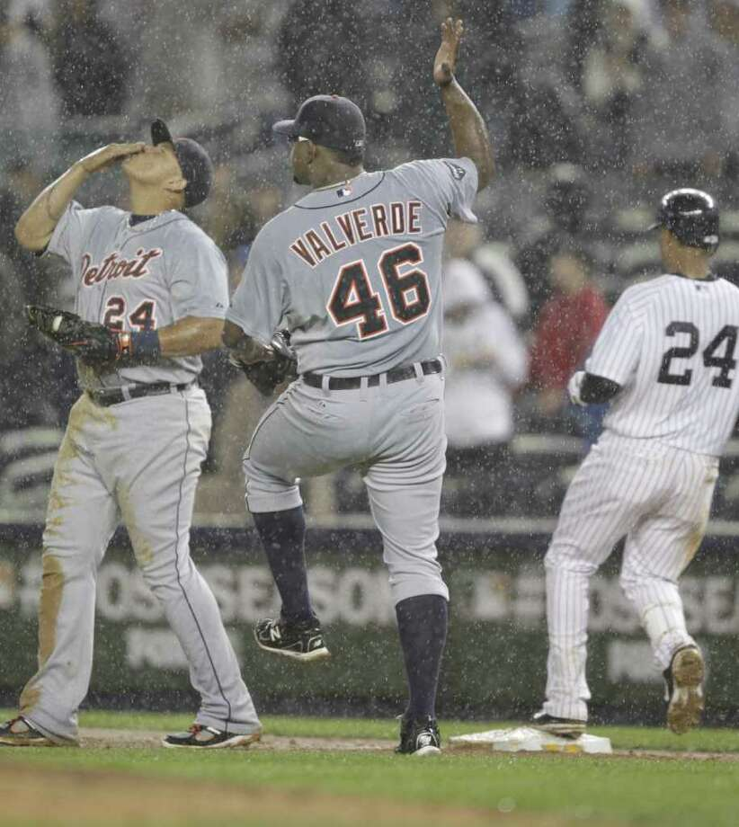 Detroit Tigers Miguel Cabrera and Jose Valverde celebrate after closing out the ninth inning against the New York Yankees in Game 2 of the American League Division Series at Yankee Stadium in the Bronx, New York, Sunday, October 2, 2011. The Tigers defeated the Yankees, 5-3. (Julian H. Gonzalez/Detroit Free Press/MCT) Photo: Julian H. Gonzalez / Detroit Free Press