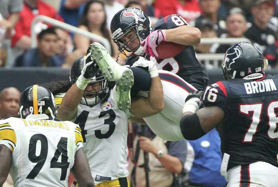 Houston Texans tight end James Casey (86) is upended by Pittsburgh Steelers strong safety Troy Polamalu (43) during the second quarter of a NFL football game at Reliant Stadium on Sunday, Oct. 2, 2011, in Houston. ( Nick de la Torre / Houston Chronicle ) Photo: Nick De La Torre / © 2011  Houston Chronicle