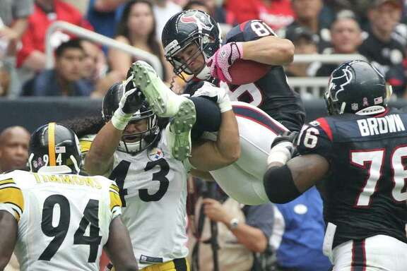 Houston Texans tight end James Casey (86) is upended by Pittsburgh Steelers strong safety Troy Polamalu (43) during the second quarter of a NFL football game at Reliant Stadium on Sunday, Oct. 2, 2011, in Houston. ( Nick de la Torre / Houston Chronicle )