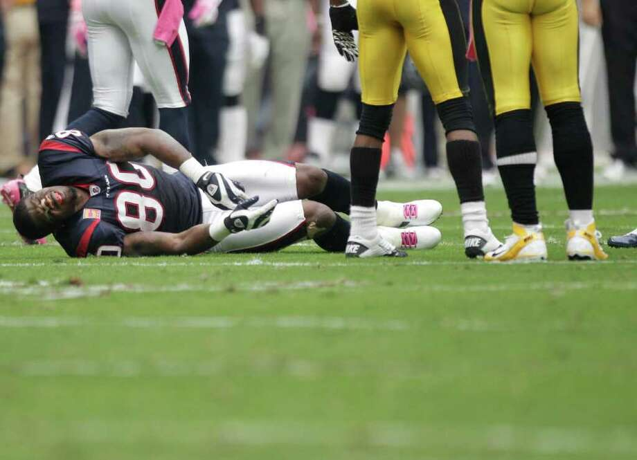 Brett Coomer: Chronicle AND THE CROWD GOES MILD: The noise at Reliant Stadium dipped to church-mouse levels Sunday when Texans wide receiver Andre Johnson (80) went down with a hamstring injury. Johnson left the game, and the severity of the injury still is unknown. Photo: Brett Coomer / © 2011  Houston Chronicle