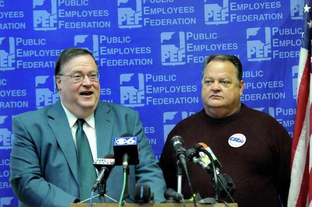 PEF president Ken Brynien, left, and CSEA president Danny Donohue, right, speak during a news conference about state worker layoffs on Wednesday, April 8, 2009, at PEF Headquarters in Latham, N.Y. (Cindy Schultz / Times Union) Photo: CINDY SCHULTZ / 00003296A