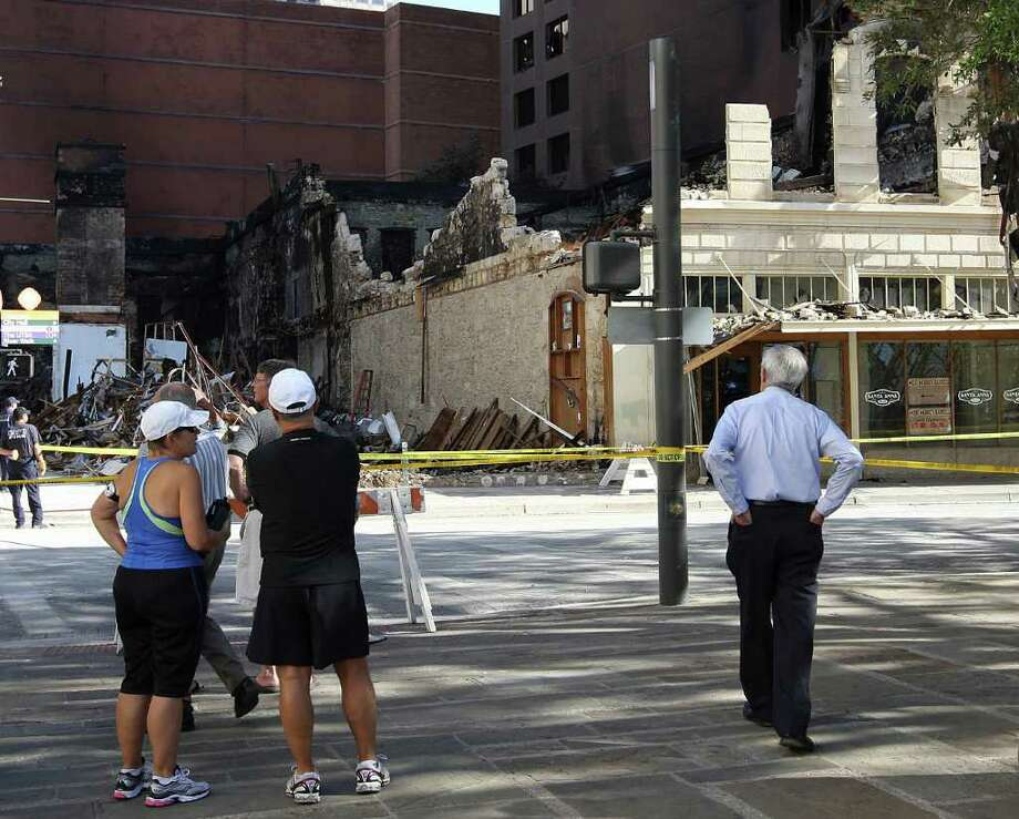 The Wolfson Building was destroyed in a weekend fire that also damaged the bottom seven floors of the adjacent Riverview Towers high-rise. Fire Chief Charles Hood said the fire's cause and its cost in damage have not been determined. Photo: Jerry Lara/glara@express-news.net / SAN ANTONIO EXPRESS-NEWS
