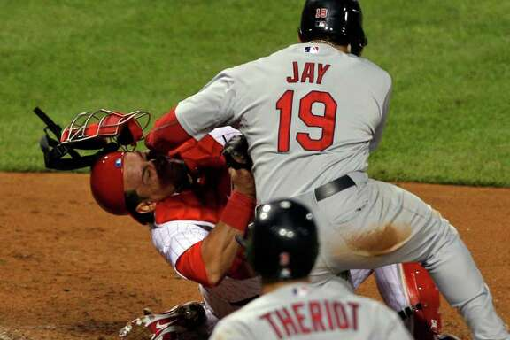Philadelphia Phillies catcher Carlos Ruiz (51) makes the tag to get St. Louis Cardinals' Jon Jay (19) out at home during the fourth inning of baseball's Game 2 of the National League division series Sunday, Oct. 2, 2011 in Philadelphia. (AP Photo/Mel Evans)