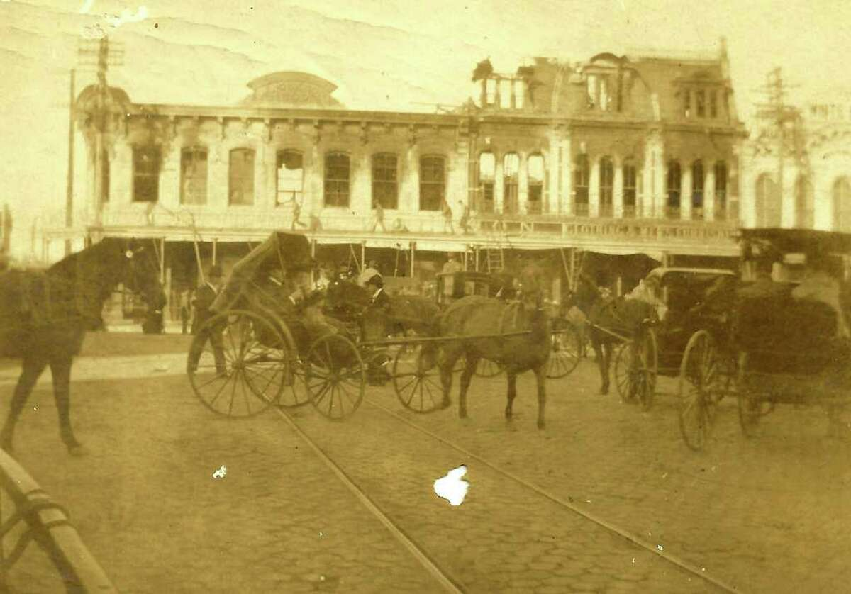 The Wolfson store on Main Plaza is seen shortly after a fire in January 1904. The building burned again in a four-alarm fire early Saturday Oct. 1, 2011.