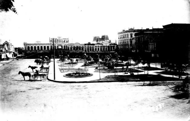 Looking north on Main Plaza in 1893. From left to right, L. Wolfson's dry goods store, the White Elephant saloon and Charles J. Langholtz's saddlery. The twin mansard roofs visible in the center belong to the Old Court House (1882-1892) on Soledad Street. Photo: Courtesy Photo/San Antonio Conservation Society,  Raba Collection