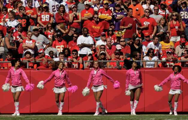Kansas City Chiefs cheerleaders wear pink for breast cancer awareness during the first half of an NFL football game against the Minnesota Vikings Sunday, Oct. 2, 2011 in Kansas City, Mo. (AP Photo/Charlie Riedel) Photo: Charlie Riedel, Associated Press / AP