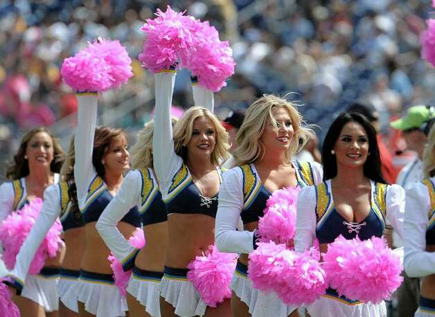 San Diego Chargers cheerleaders cheer on the sidelines during an NFL football game against the Miami Dolphins Sunday, Oct. 2, 2011, in San Diego.  (AP Photo/Denis Poroy) Photo: DENIS POROY, Associated Press / FR59680 AP