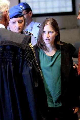 PERUGIA, ITALY - OCTOBER 03:  Amanda Knox arrives at Perugia's Court of Appeal the day of the verdict in her and Raffaele Sollecito's appeal of their murder convictions on October 3, 2011 in Perugia, Italy. American student Amanda Knox and her Italian ex-boyfriend Raffaele Sollecito were convicted in 2009 of killing their British roommate Meredith Kercher in Perugia, Italy in 2007. The jury in their appeal is expected to retire to consider their verdict later today. They have served nearly four years in jail after being sentenced to 26 and 25 years respectively. Photo: Franco Origlia, Getty Images / 2011 Getty Images