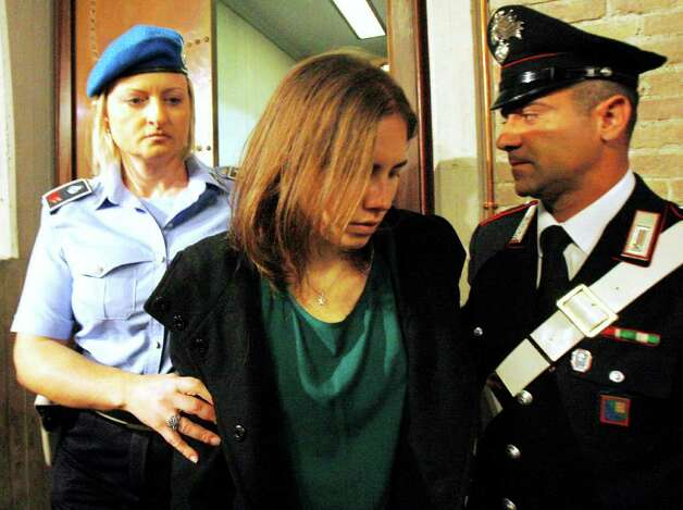 Amanda Knox, center, is escorted as she arrives for an appeal hearing at the Perugia court, central Italy, Monday, Oct. 3, 2011. The 24-year-old Knox looked tense as she entered a packed courthouse. She is expected to address the court in a final plea of her innocence. A verdict is expected later Monday. Photo: Antonio Calanni, AP / AP