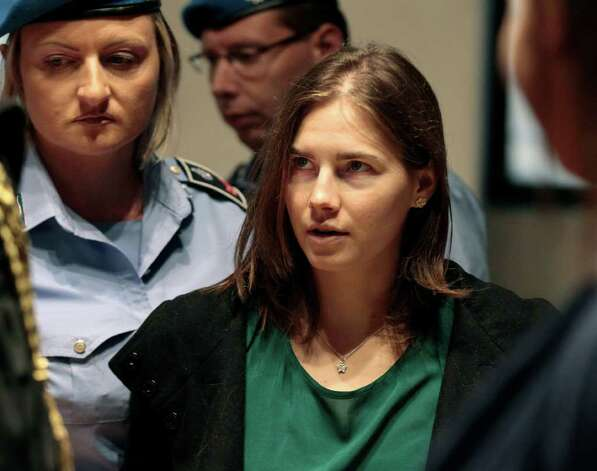 Amanda Knox is escorted as she arrives for an appeal hearing at the Perugia court, central Italy, Monday, Oct. 3, 2011. The 24-year-old Knox looked tense as she entered a packed courthouse. She is expected to address the court in a final plea of her innocence. A verdict is expected later Monday. Photo: Pier Paolo Cito, AP / AP