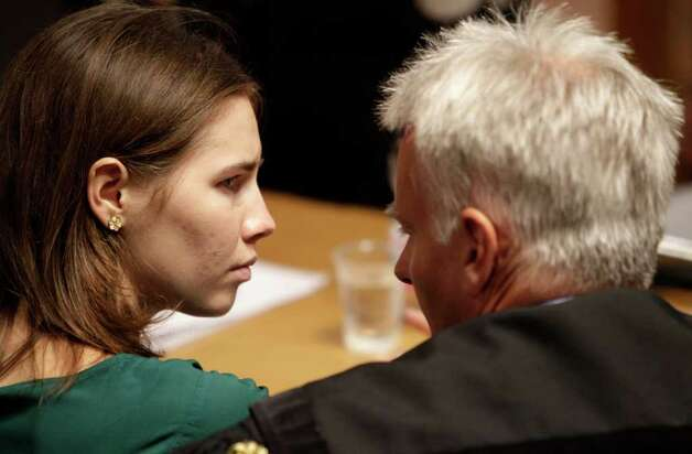Amanda Knox, left, talks to her lawyer Carlo Dalla Vedova prior to an appeal hearing, at the Perugia court, central Italy, Monday, Oct. 3, 2011. The 24-year-old Knox looked tense as she entered a packed courthouse. She is expected to address the court in a final plea of her innocence. A verdict is expected later Monday. Photo: Pier Paolo Cito, AP / AP