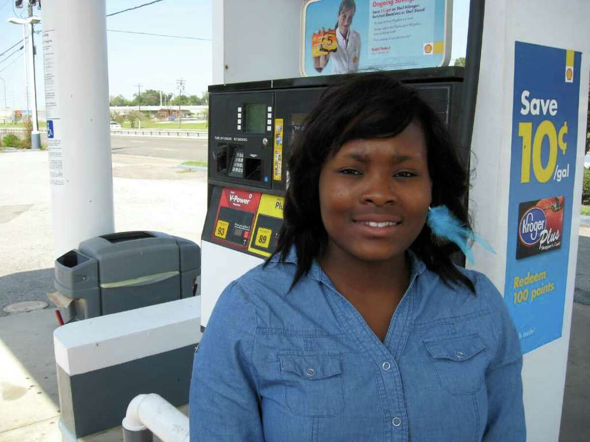 Keyonna Henderson, 17, a full-time Lamar University nursing student, buys $20 worth of gasoline at a Shell station on her way back to Houston on Friday from school. She said she buys anywhere from $30 to $40 worth of gasoline a week, so every drop in price helps her out. Dan Wallach/The Enterprise