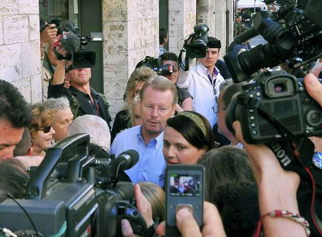 Amanda Knox's father. Kurt Knox, is surrounded by photographers as he arrives for an appeal hearing at the Perugia court, central Italy, Monday, Oct. 3, 2011. Knox, an American student, was convicted of sexually assaulting and murdering Meredith Kercher, her British roommate in Perugia, and sentenced to 26 years in prison. Knox's boyfriend at the time of the 2007 murder, Raffaele Sollecito of Italy, was convicted of the same charges and sentenced to 25 years. Both deny wrongdoing and have appealed the December 2009 verdict. (AP Photo/Antonio Calanni) Photo: Antonio Calanni, ASSOCIATED PRESS / AP2011