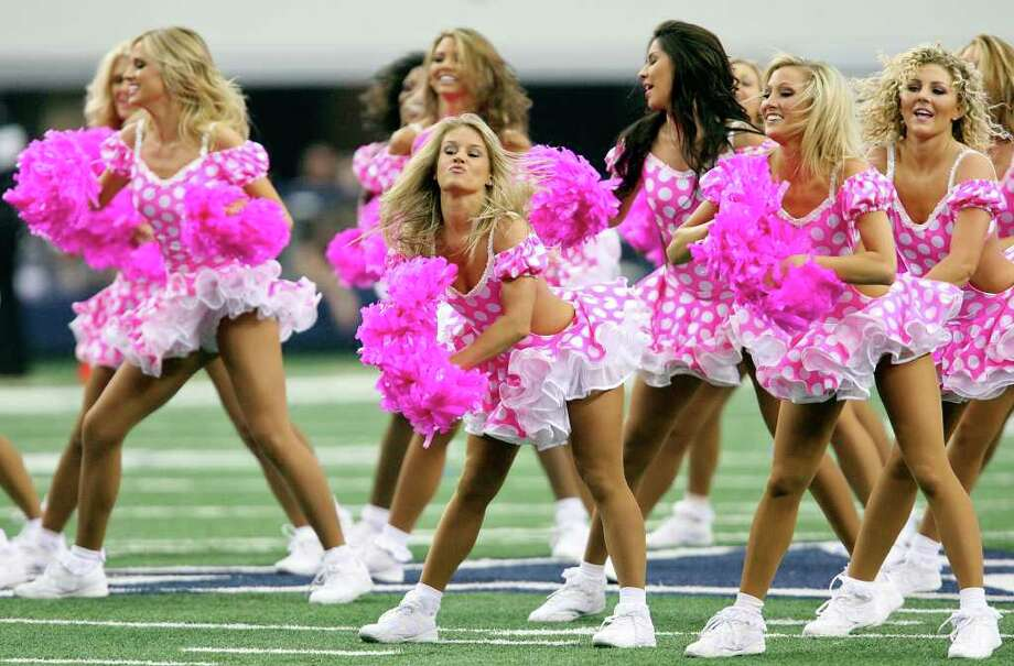 FOR SPORTS - Members of the Dallas Cowboys Cheerleaders perform in pink for breast cancer awareness during the game with the  Detroit Lions Sunday Oct. 2, 2011 at Cowboys Stadium in Arlington, TX.  (PHOTO BY EDWARD A. ORNELAS/eaornelas@express-news.net) Photo: EDWARD A. ORNELAS, SAN ANTONIO EXPRESS-NEWS / © SAN ANTONIO EXPRESS-NEWS (NFS)