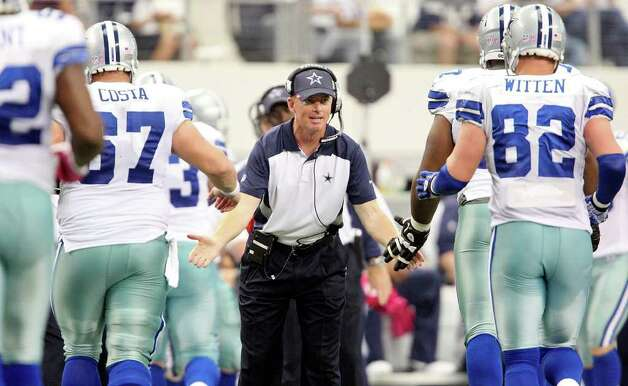 FOR SPORTS - Dallas Cowboys head coach Jason Garrett meets players as the walk to the sidelines during second half action against the Detroit Lions Sunday Oct. 2, 2011 at Cowboys Stadium in Arlington, TX. The Lions won 34-30.  (PHOTO BY EDWARD A. ORNELAS/eaornelas@express-news.net) Photo: EDWARD A. ORNELAS, SAN ANTONIO EXPRESS-NEWS / © SAN ANTONIO EXPRESS-NEWS (NFS)