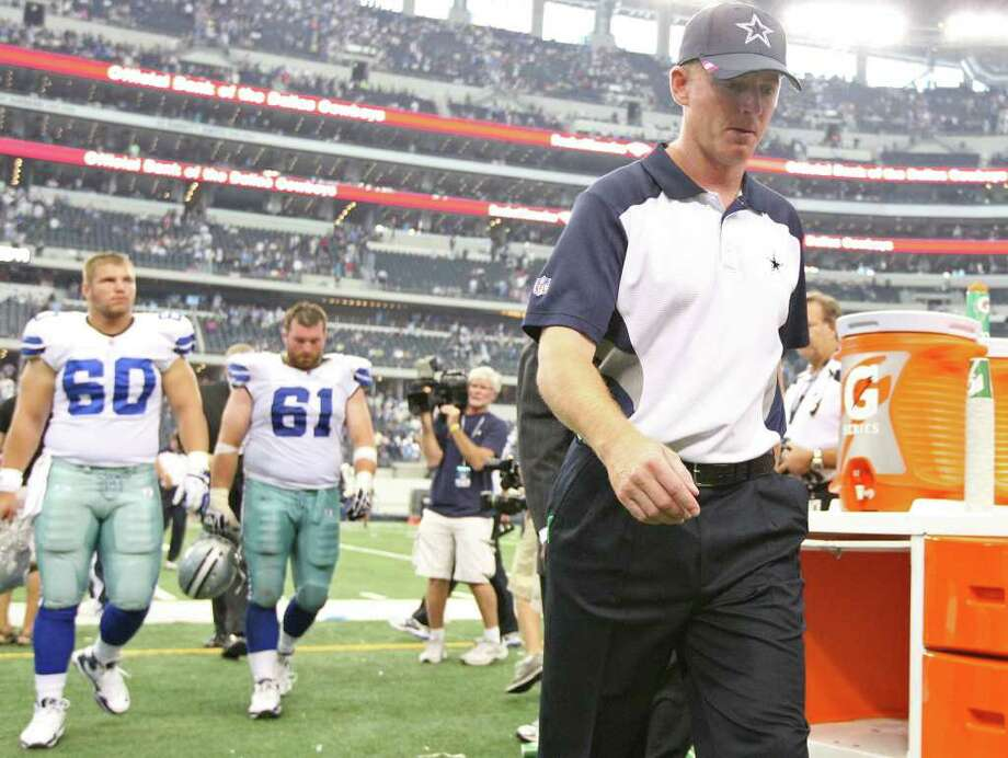 Cowboys coach Jason Garrett and players leave the field after seeing the Lions rally from a 27-3 deficit Sunday. Photo: EDWARD A. ORNELAS, SAN ANTONIO EXPRESS-NEWS / © SAN ANTONIO EXPRESS-NEWS (NFS)