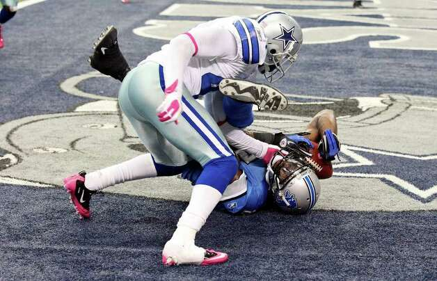 FOR SPORTS - Detroit Lions' Calvin Johnson comes down with the game winning touchdown pass in the end zone as he is defended by Dallas Cowboys' Terence Newman during second half action Sunday Oct. 2, 2011 at Cowboys Stadium in Arlington, TX. The Lions won 34-30.  (PHOTO BY EDWARD A. ORNELAS/eaornelas@express-news.net) Photo: EDWARD A. ORNELAS, SAN ANTONIO EXPRESS-NEWS / © SAN ANTONIO EXPRESS-NEWS (NFS)