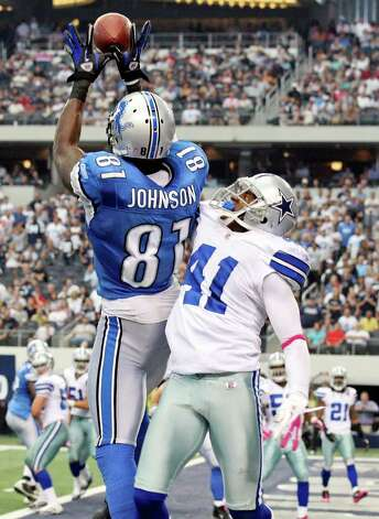 FOR SPORTS - Detroit Lions' Calvin Johnson goes up for the game winning touchdown pass as he is defended by Dallas Cowboys' Terence Newman during second half action Sunday Oct. 2, 2011 at Cowboys Stadium in Arlington, TX. The Lions won 34-30.  (PHOTO BY EDWARD A. ORNELAS/eaornelas@express-news.net) Photo: EDWARD A. ORNELAS, SAN ANTONIO EXPRESS-NEWS / © SAN ANTONIO EXPRESS-NEWS (NFS)