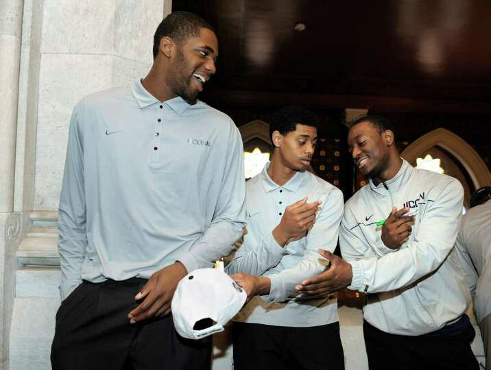 Connecticut men's basketball players Alex Oriakhi, Jeremy Lamb and Kemba Walker, from left, wait to
