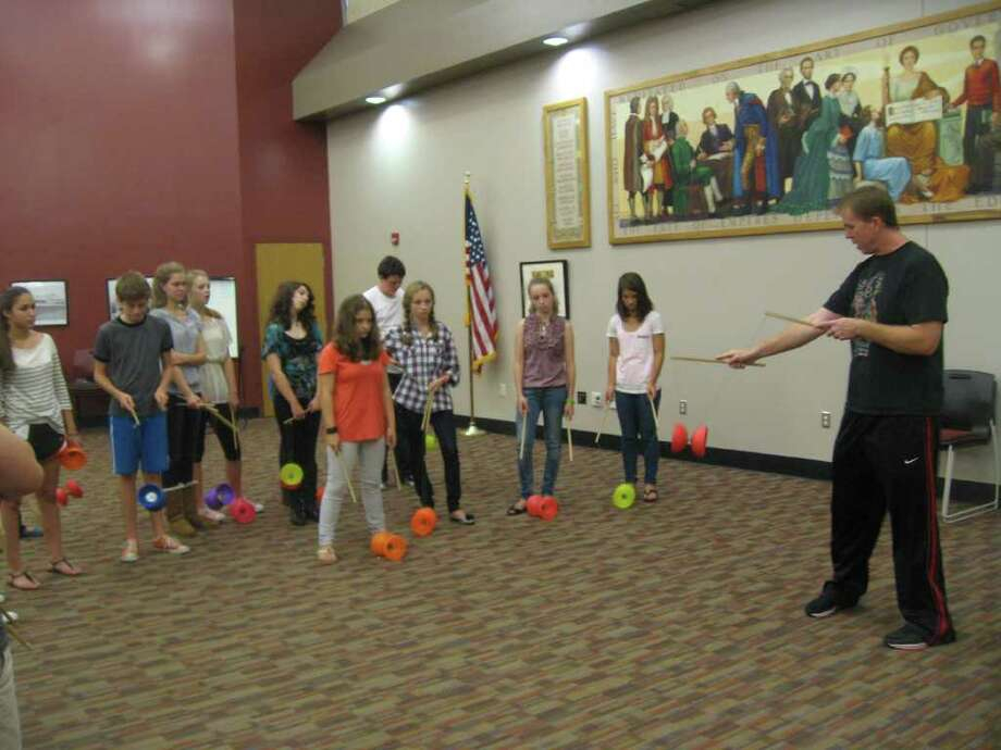 Chris Ellison from ìCirque de Jourî shows students at New Canaan High School how to use Chinese yoyos. Photo: Contributed Photo