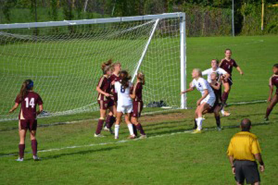 Staples' Ryan Kirshner heads in a loose ball in the box after a corner kick to tie the game, 2-2 Saturday, against St. Joseph. St. Joe's came back and nipped the Lady Wreckers, 3-2. Photo: Contributed Photo