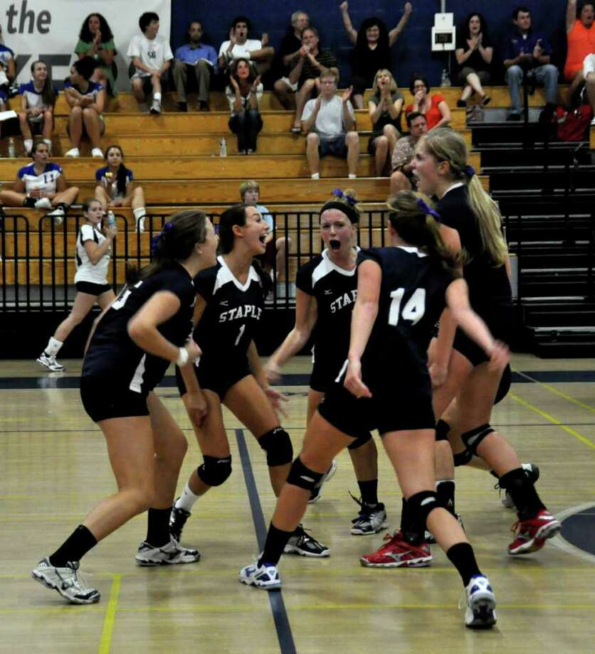 The Staples volleyball team show its unity against Danbury Sept. 26. Staples raised its record to 7-0 with a 3-0 win at Bassick Friday. Photo: Suzanne Kalb / Contributed Photo