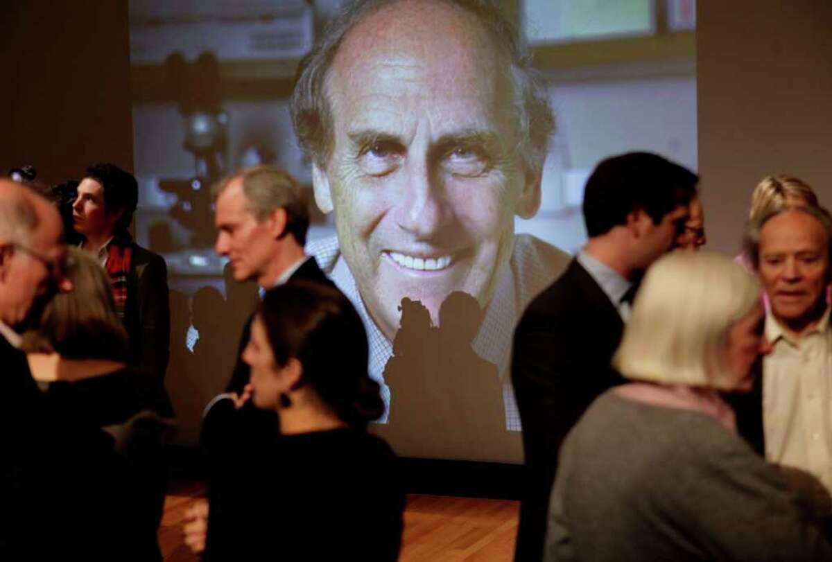 Family, friends and colleagues socialize in front of a photo of Ralph Steinman during a ceremony to honor his receiving the Nobel Prize in medicine at Rockefeller University in New York, Monday, Oct. 3, 2011. Steinman, a cell biologist, was awarded the Nobel Prize in medicine on Monday for his discoveries about the immune system but hours later his university said that he had been dead for three days. The Nobel committee had been unaware of Canadian-born Ralph Steinman's death. (AP Photo/Seth Wenig)