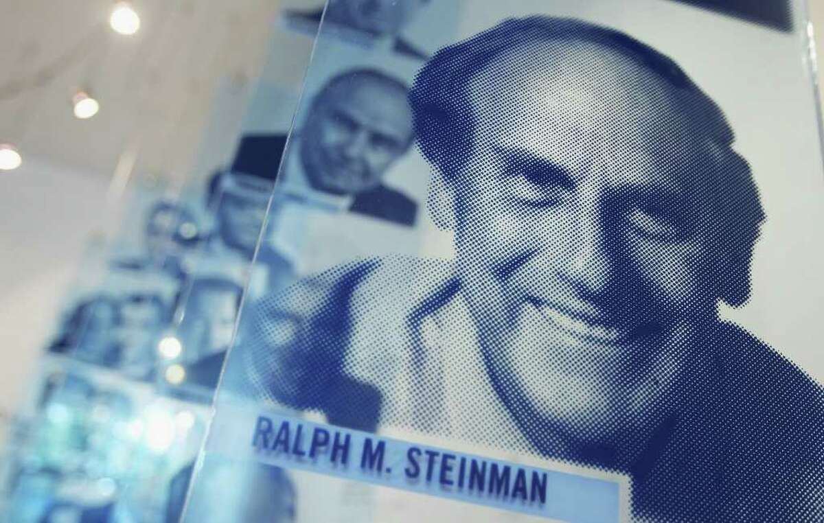 A photograph of deceased 2011 Nobel Prize in Medicine winner Ralph Steinman is seen at Rockefeller University on October 3, 2011 in New York City. Steinman, who passed away on September 30, was awarded for his discovery of the immune system's dendritic cells in the 1970s at Rockefeller University. Nobel Prizes are not awarded posthumously and the Nobel Committee was unaware of Steinman's death. (Photo by Mario Tama/Getty Images)