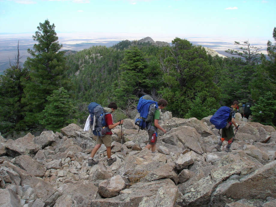 Attention to each step is imperative when hiking the rocky trail along Tooth of Time Ridge. Left to right are Alex Lagas, Stephen Rogalski and Liam Raftery. Photo: Contributed Photo