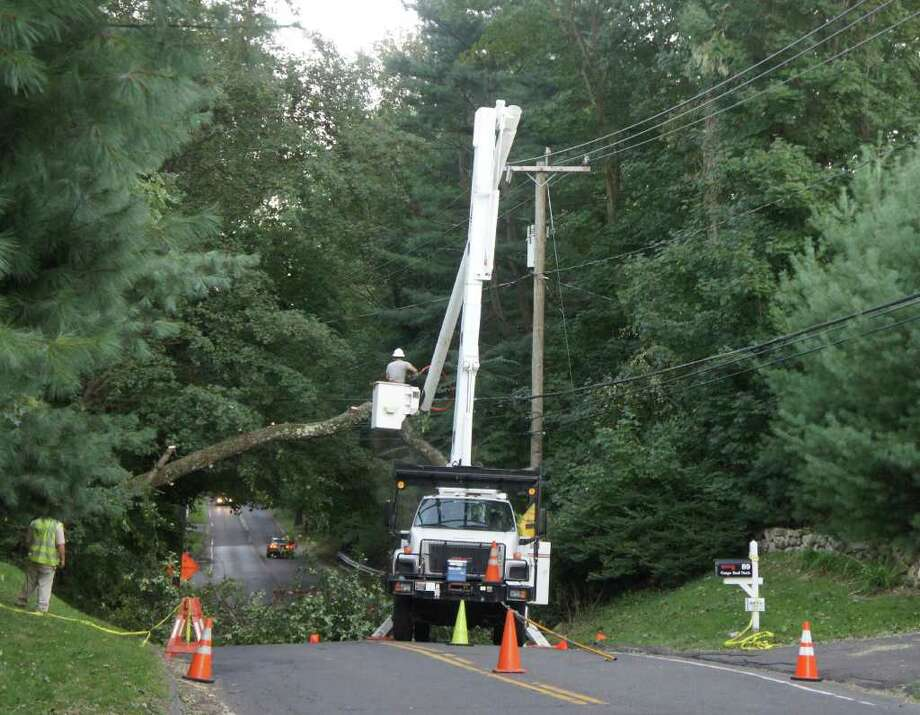 Following Tropical Storm Irene, a Connecticut Light & Power crew removes a tree caught in power lines on Compo Road North on Tuesday, Aug. 30, 2011. A forum to discuss CL&P power outages caused by Tropical Storm Irene is scheduled for Thursday, Oct. 13 at 7 p.m. in Town Hall. Photo: Paul Schott / Westport News