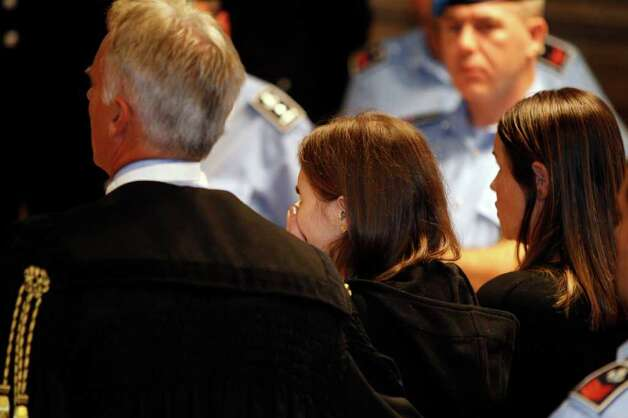 Amanda Knox, centre,  reacts after hearing the verdict that overturns her conviction and acquits her of murdering her British roommate Meredith Kercher, at the Perugia court, central Italy, Monday. (AP) Photo: Pier Paolo Cito, ASSOCIATED PRESS / AP2011