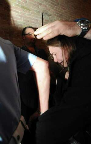 Amanda Knox bursts into tears as she walks away after hearing the verdict that overturns her conviction and acquits her of murdering her British roomate Meredith Kercher, at the Perugia court, Italy, Monday Oct. 3, 2011. An Italian appeals court has thrown out Amanda Knox's murder conviction and ordered the young American freed after nearly four years in prison for the death of her British roommate. Knox collapsed in tears after the verdict was read out Monday. Her co-defendant, Raffaele Sollecito, also was cleared of killing 21-year-old Meredith Kercher in 2007. Photo: Pietro Crocchioni, AP / Ansa Pool